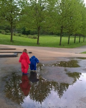 Kids splashing in puddles, reflections