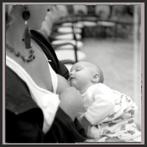 fashionable woman breastfeeding in public
